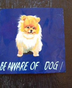 Folk art beware of Pomeranian dog hand painted on metal by a sign painter in Nepal, paying fair trade wages
