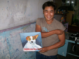 The artist, Jit Gurung, with his portrait of a Jack Russell Terrier
