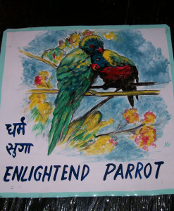 Folk art portrait of love birds hand painted on metal in Nepal.