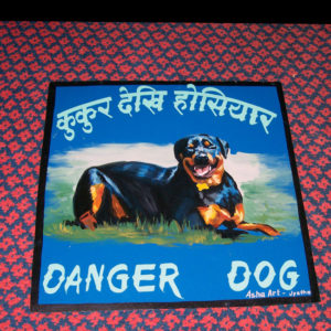 Folk art Beware of Rottweiler hand painted on metal by a sign painter in Nepal