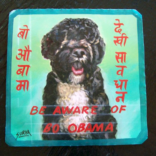 Folk Art portrait of Bo Obama hand painted on metal by a Nepali signboard artist.