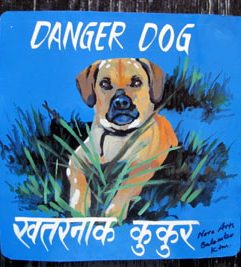 Folk art Beware of Puggle sign hand painted on metal from Nepal