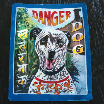 Hand painted portrait of a brindle Pit Bull Terrier on metal by a Nepali signboard artist.
