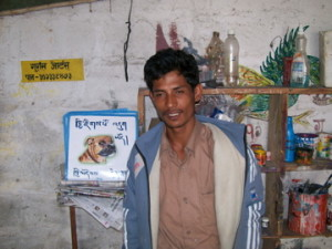 Sign painter from Nepal with beware of dog signs