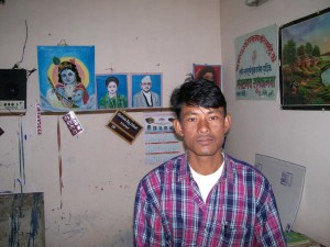 Nepali sign painter in his studio