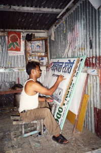 Sign board artist at work