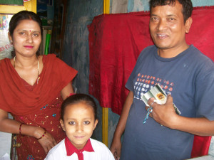 Folk artist and family in Kathmandu