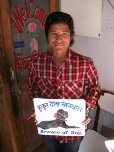 Nepali sign painter with a Black Standard Poodle