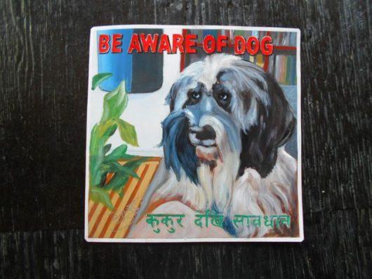 Folk art Beware of Tibetan Terrier hand painted on metal by a sign painter in Kathmandu, Nepal