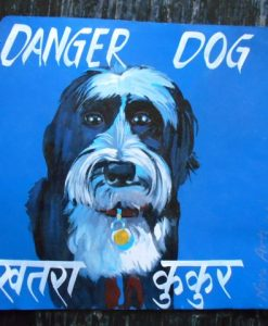 Zelda the Tibetan Terrier is hand painted on metal by a Nepali sign painter.