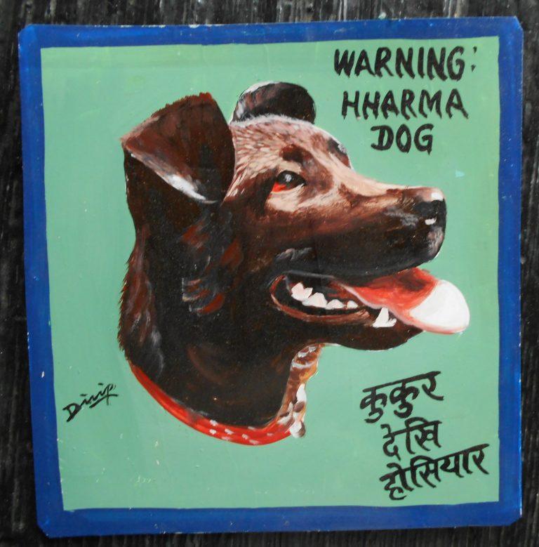 Folk art beware of dog sign hand painted on metal in Nepal