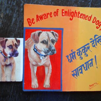 Folk art beware of dog sign featuring a Boxer mix hand painted on metal in Nepal