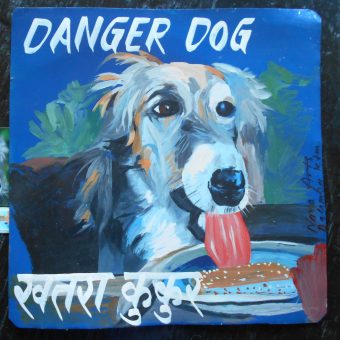 Folk art portrait of Lola the Borzoi eating ice cream hand painted on metal in Nepal.