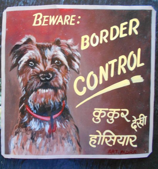 a folk art portrait of Rooney the Border Terrier hand painted on metal by Indra Lama