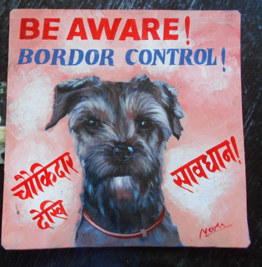 folk art portrait of Rooney the Border Terrier hand painted on metal by Megh Raj Thapa