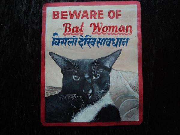 Folk art portrait of a black cat