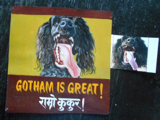 Folk art portrait of a black standard Poodle hand painted on metal in Nepal