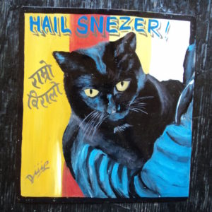 Folk art portrait of a black cat hand painted in Nepal