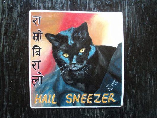 Folk art portrait of a black cat hand painted in Nepal