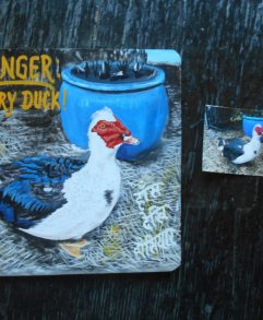 Folk art beware of Muscovy Duck portrait hand painted on metal in Nepal