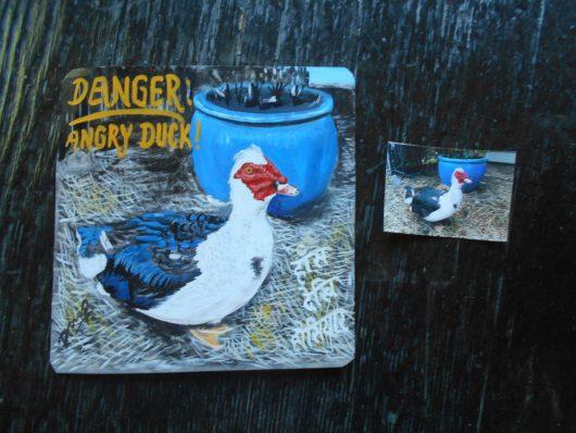 Folk art beware of Muscovy Duck portrait hand painted on metal in Nepal